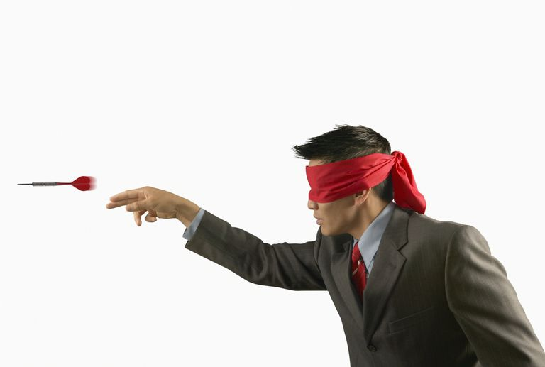blindfolded-man-throwing-darts-55974411-5a24778fbeba33003715f4b5